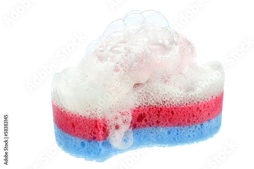 Sponge and soap on white background