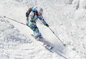 Skier on the bumpy slope