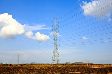 electric high voltage power post with blue sky