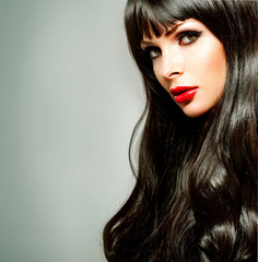 brunette with long hair and red lipstick