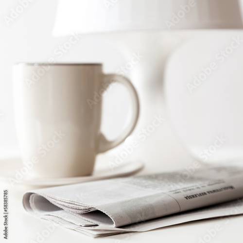 Newspaper and a coffee cup