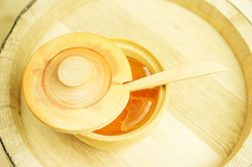 Honey in a wooden bowl