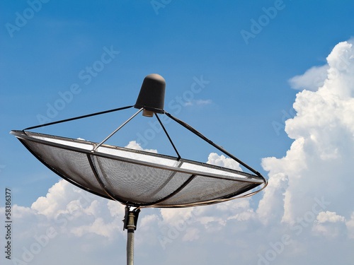 Satellite communication dish on blue sky background