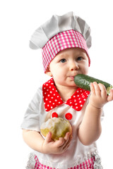 Child cook girl wearing chef hat with fresh vegetables
