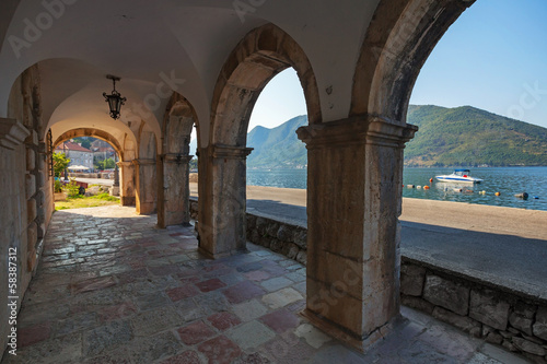 Dark archway in the old house in Perast town, Montenegro