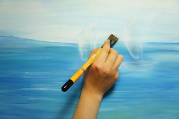 Painter paints his beautiful picture