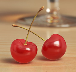 Two red cherries with bokeh effect