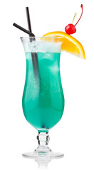 Turquoise alcohol cocktail with berries and orange slice isolate