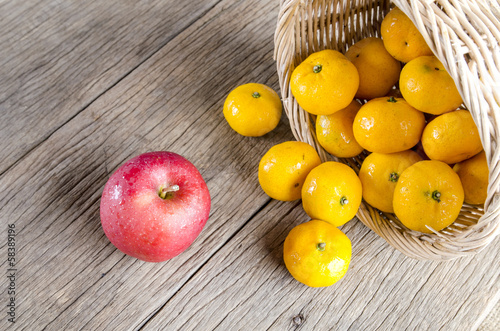 apple and oranges on the wooden floor