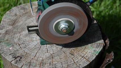 sharpening blade on black electric sharpener