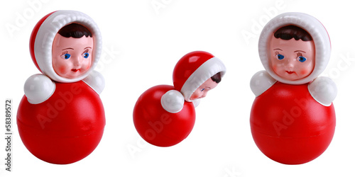 Bright red roly-poly toy on the white