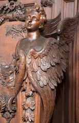 Antwerp - Carved cherub in St. Charles Borromeo church
