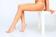 Beautiful female legs, white background