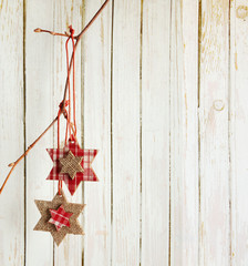 Christmas decoration hanging over  wooden board
