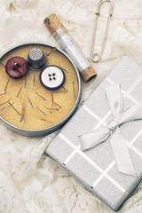 box of thread and needles