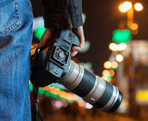 Photographer with camera in the city