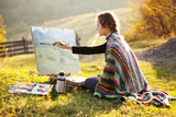 Fototapety Young artist painting an autumn landscape