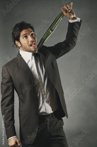 Desperate businessman strangled by the tie