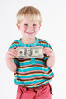 Smiling boy holding a bank note in his hands