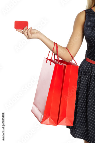 Packages and card in hand of young girl