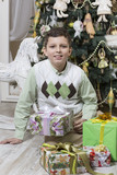 Boy with many Christmas gifts