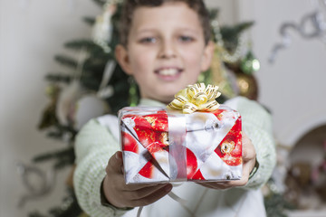 Boy gives a Christmas gift