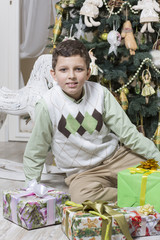 Young boy under Christmas tree