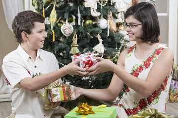 Brother and sister exchange Christmas gifts