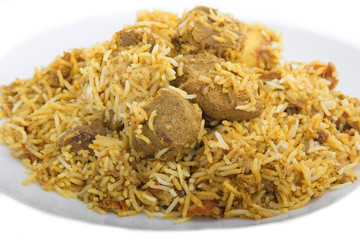 Lamb biryani with spicy rice served with potatoes