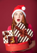 Redhead girl with gifts on red background