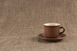Brown coffee cup  on burlap