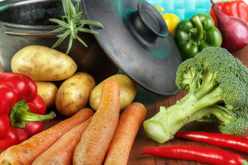 Vegetable ingredients with cast iron pan on table
