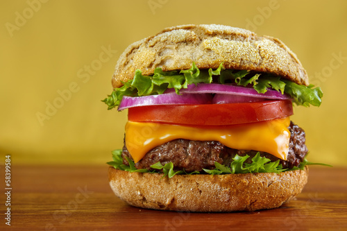 Multigrain bun hamburger on wooden table