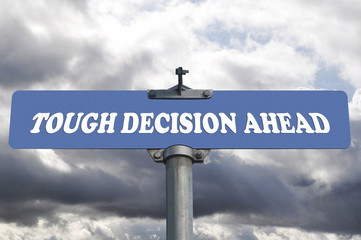 Tough decision ahead road sign