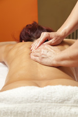 Woman receiving a therapeutic massage and lymph drainage