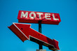 Vintage, neon, red hotel sign with a red arrow