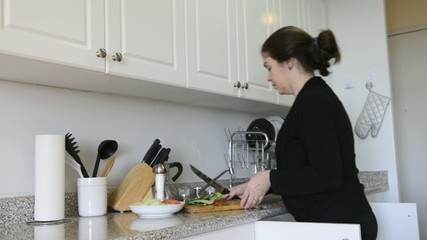Woman working in her kitchen at home