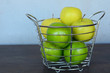 Green and Yellow Apples in Steel Basket