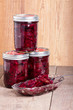 Pickled beets in jars and bowl