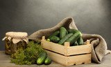 fresh cucumbers in wooden box, pickles and dill,