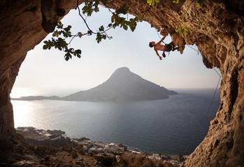 Rock climber on cliff. Kalymnos Island, Greece.