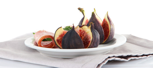 Tasty figs with ham, isolated on white
