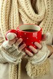 Female hands with hot drink, on close-up