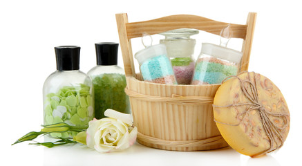 Aromatic salts in glass bottles, in wooden bucket, isolated