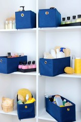 Blue textile boxes with cosmetic products for personal care in