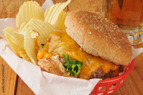 Cheeseburger with chips and beer