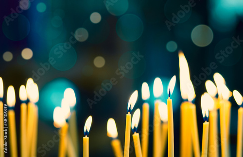 canvas print picture Church candles on the background bokeh