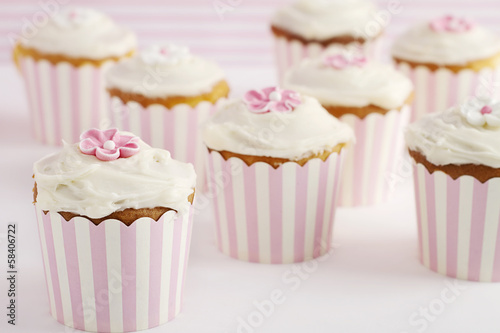 Dessert table of pink and white retro style cupcakes