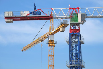 Closeup Of Tower Cranes At A Construction Site