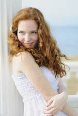 beautiful red-haired girl near the sea